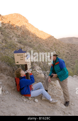 Caucasian Couple 50-60 years Drink Bottled Water at South Mountain Park Phoenix AZ USA - Stock Photo