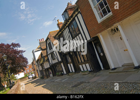 Horizontal wide angle of the beautiful Tudor cottages in Church Square in quaint old Rye on a sunny day. - Stock Photo