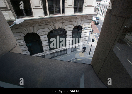A view down onto the alleyway next to a newly built office building. - Stock Photo