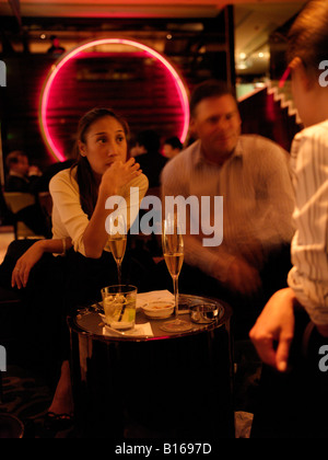 Guest enjoying drinks at MO Bar in the  Landmark Mandarin Oriental Hotel. - Stock Photo