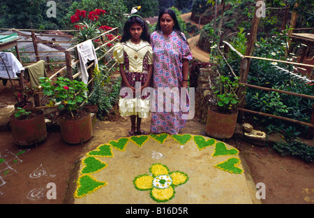 Tamils with a 'Rangoli' a traditional art form of floor paintings made of colored powder. Adam's peak. Sri Lanka. - Stock Photo