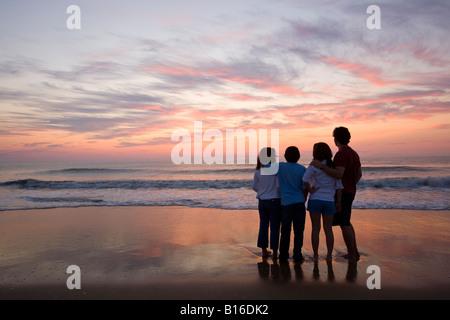 Mixed Race family at beach - Stock Photo