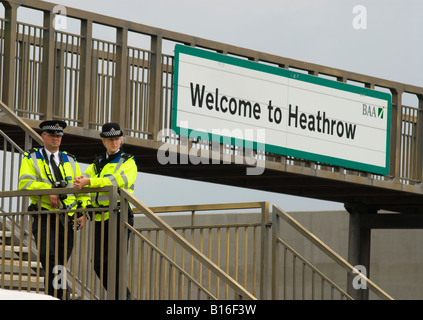 Police officers on duty near London Heathrow Airport during protest against 3rd runway, 31st May 2008, Hatton Cross, - Stock Photo