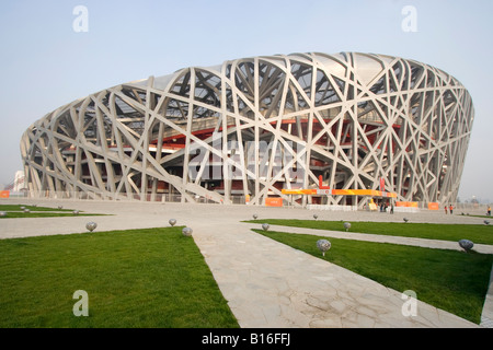 Beijing National Stadium also known as the Bird's Nest for its architecture situated in the 'Olympic Green' village. - Stock Photo