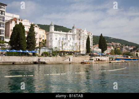 Opatija Istria Croatia Europe May The Casino and sea front hotels with walkers on the 12km long Setaliste Franza - Stock Photo