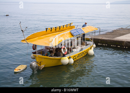 Opatija Istria Croatia Europe May The Glass boat water taxi drawing up to one of the jetties - Stock Photo
