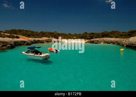 Boats moored up in idyllic bay in Menorca - Stock Photo
