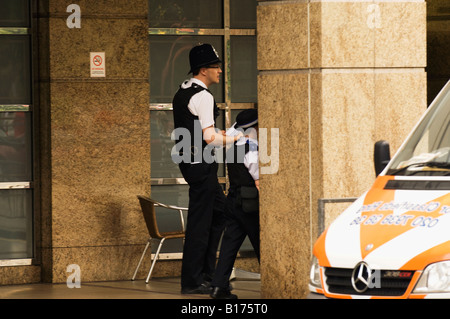 England, London, Hammersmith, Police officers walking - Stock Photo