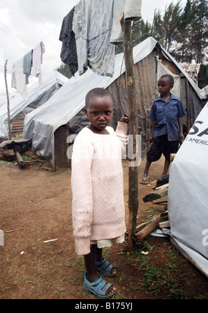 kenian refugee girl in a refugee camp for IDP´s (Internally Displaced People) in Burnt Forest/Kenya - Stock Photo