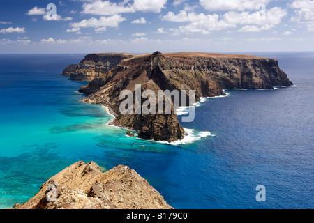 View of Ilhéu de Baixo ou da Cal island off the coast of the Portuguese Atlantic island of Porto Santo. - Stock Photo