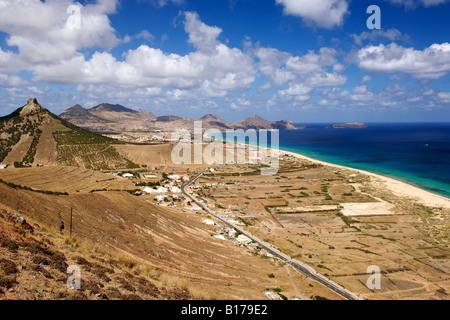 View along the beach of the Portuguese Atlantic island of Porto Santo from Miradouro das Flores. - Stock Photo