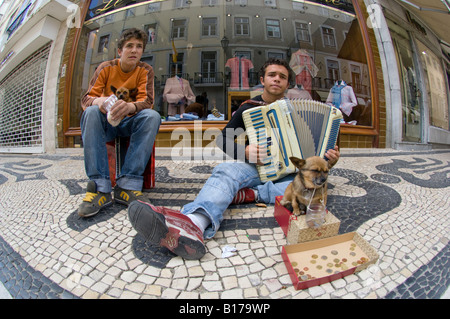Photo of two buskers on Augusta Street. Lisbon, Portugal. - Stock Photo