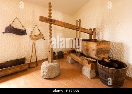 Screw-operated wine press in the Museu do Cardina museum on the Portuguese Atlantic island of Porto Santo. - Stock Photo