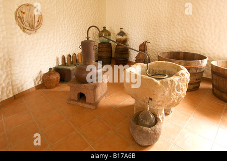 Distilling equipment in the Museu do Cardina museum on the Portuguese Atlantic island of Porto Santo. - Stock Photo