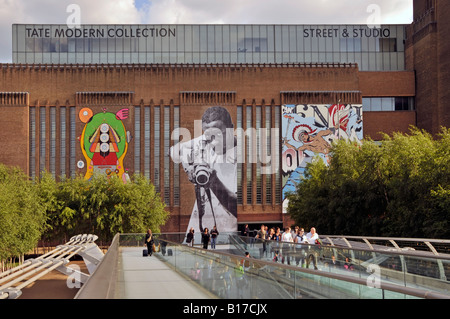 Tate Modern brick walls used for street art display of graffiti on this refurbished Bankside power station seen - Stock Photo