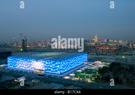 The Water Cube National Aquatics Center swimming arena and National Stadium at the Olympics Park Beijing China - Stock Photo
