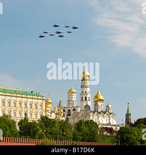Russian 'Swifts' and 'Russian Knights' fly in formation over the Kremlin cathedral domes, Moscow Victory Day parade, - Stock Photo
