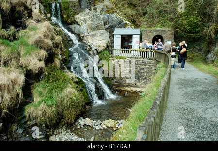 Visitors going into the laxey mine shaft - Stock Photo