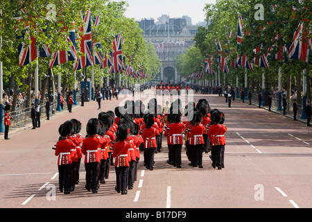 The Guards Regiment marching down the flag lined Mall in London - Stock Photo