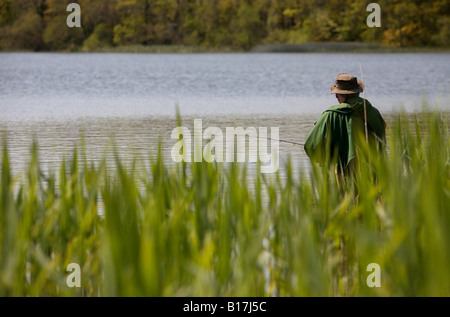 man flyfishing in a lake in county down northern ireland - Stock Photo