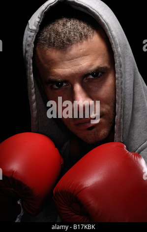 Boxer in a hooded robe - Stock Photo