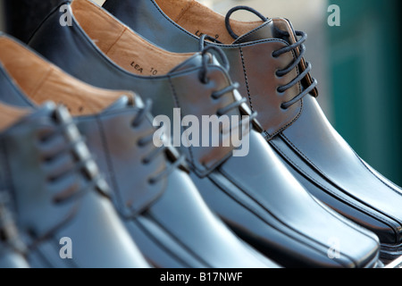 row of new mens black leather lace up shoes on sales display outside shoe shop northern ireland - Stock Photo