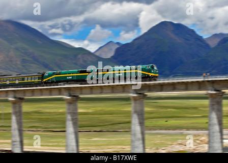 China, Tibet, Train on bridge - Stock Photo