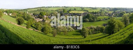 An early morning panoramic view of the Cotswold village of Naunton, in the valley of the infant River Windrush, - Stock Photo