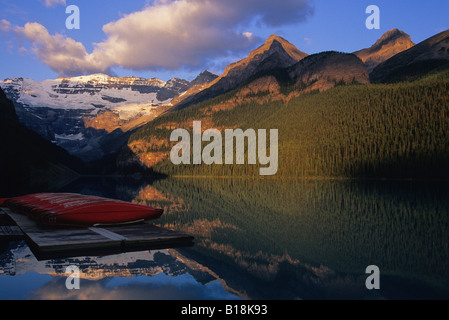 Lake Louise and canoes on the dock in the early morning at sunrise Banff National Park, Alberta, Canada. - Stock Photo