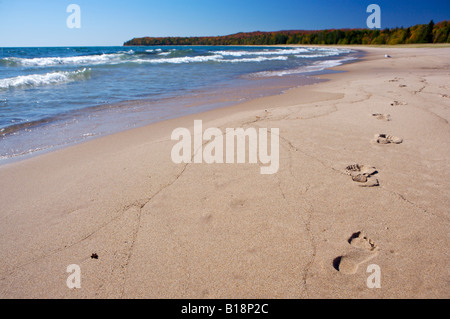 Footprints in the sand along the beach of Pancake Bay in Pancake Bay Provincial Park, Lake Superior, Great Lakes, - Stock Photo