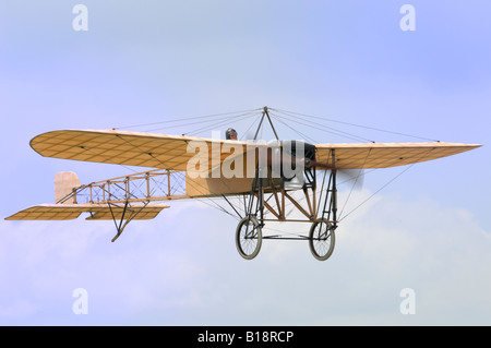 A 1909 Bleriot XI in flight. - Stock Photo