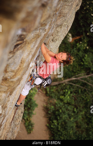 Woman climbing Special Forces, 5.11a. The Fortress. Skaha Bluffs. Penticton, British Columbia, Canada. - Stock Photo