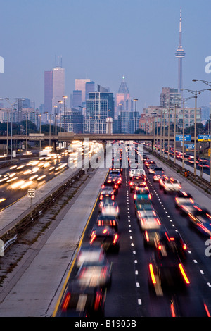 Rush-hour traffic on QEW (Queen Elizabeth Way) and Toronto city skyline, Toronto, Ontario, Canada. - Stock Photo