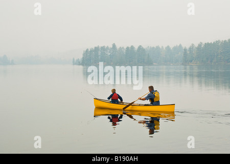 Young/middle-aged man going fishing with son on Source Lake, Algonquin Provincial Park, Ontario, Canada. - Stock Photo
