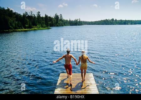 Jumping off dock, Lyons Lake, Whiteshell Provincial Park, Manitoba, Canada. - Stock Photo