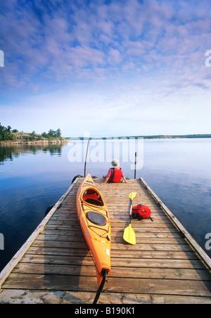 Kayak on boat dock, Nutimik Lake campground,Whiteshell Provincial Park, Manitoba, Canada. - Stock Photo