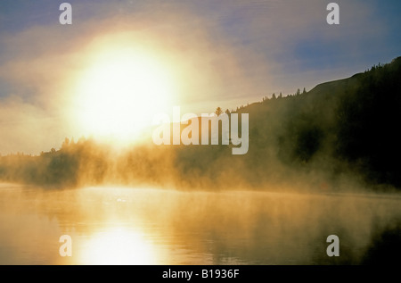 Autumn mist on the Red Deer River, Dry Island Buffalo Jump Provincial park, Alberta, Canada. - Stock Photo
