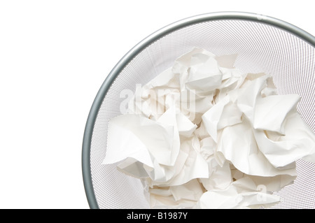 grey metal waste paper basket filled with crumpled white paper, Montreal, Quebec, Canada - Stock Photo