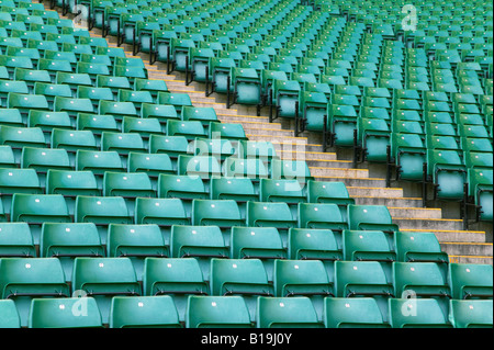 Rows of empty seats in a sports stadium - Stock Photo