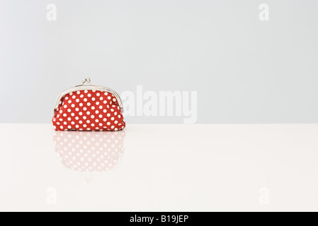 Change purse with polka dots - Stock Photo