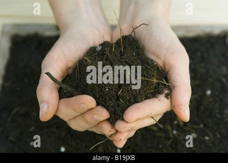 Handful of gardening soil - Stock Photo
