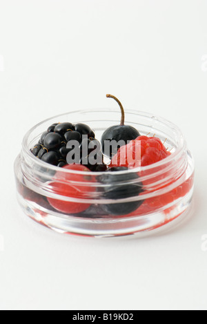 Berries in small cosmetic container, close-up - Stock Photo