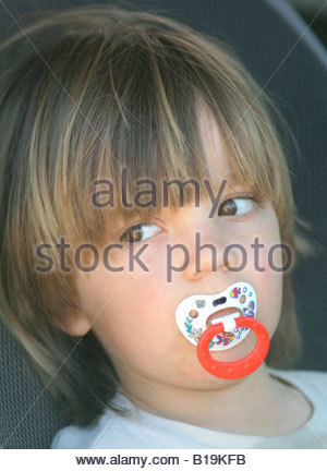 childs child with dummy in mouth little boy face portraiture portrait INDOOR OVERVIEW - Stock Photo