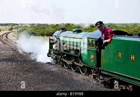 A steam locomotive of the Romney Hythe and Dymchurch Light Railway leaving the station. - Stock Photo