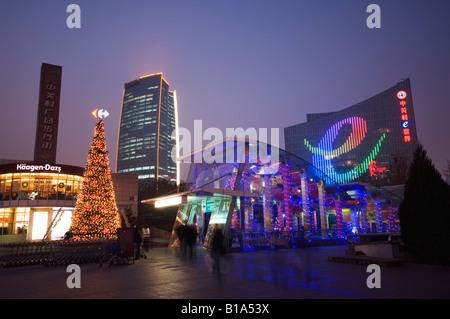 Christmas tree and decorations illuminated at night in Beijing China - Stock Photo