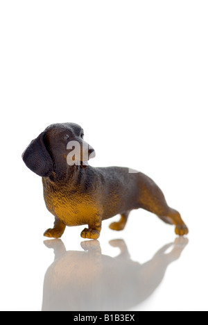 Plastic Figurine of a dachshund - Stock Photo