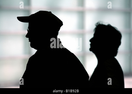 Silhouette of an elderly couple - Stock Photo
