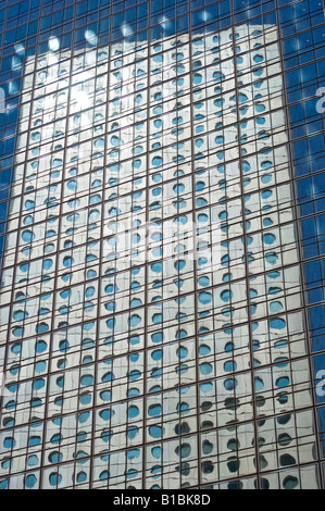 Reflection of Jardine House in the JP Morgan Building. Hong Kong Island, China. - Stock Photo
