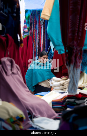 Young Ecuadorian woman on Otavalo Market in Northern Ecuador in South America - Stock Photo