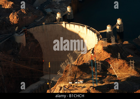 The Hoover dam as seen from the air during sunset. - Stock Photo